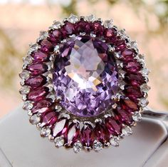 Genuine Amethyst, Garnet and White Topaz Solid 925 Sterling Silver Ring 13.01cts  Brand New! Genuine Gemstones! Not Lab Created  Alluring Amethyst center stone, accented by a stunning halo of Marquise-cut Rhodiolite Garnets and White Topaz in a stunning and majestic Solid 925 Sterling Silver Ring.  Visit my eBay store for this & more beautiful genuine gemstone jewelry. http://stores.ebay.com/HM-Fine-Jewelry-And-More