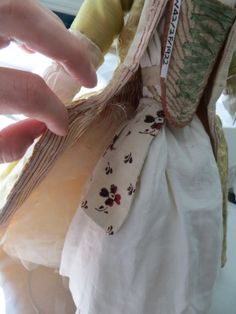 Detail of the doll's pocket under her skirts. (c) Victoria & Albert Museum