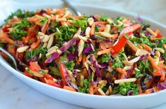 Believe or not, this salad will have you eating your vegetables (and, most surprisingly, your kale) with pleasure and abandon. Bright, bold flavors and textures abound: earthy kale; cool and crunchy carrots, bell peppers and red cabbage; toasted almonds; and a creamy peanut dressing laced with ginger, honey, spicy sriracha and fresh lime. It's meant to be a side dish, but if you're …