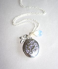 Silver Locket and Moonstone and Orchid Locket Necklace, Silver Orchid, Sterling Silver chain available. $20.00, via Etsy.
