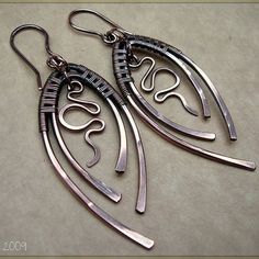 hammered silver oval shaped earrings, wire wrapping and dangles