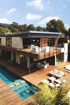 Modern home design. Stunning ground and second-storey wooden deck with cable rail!  #modern #design #cablerail