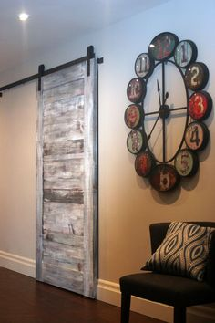 Hello all, this door divides my open concept living spaces to my hallway and bedrooms. I made this door out of rough pine and distressed it to look weathered and aged. It goes well with my distressed flooring and barn board ceiling in the dining area... Why a barn door