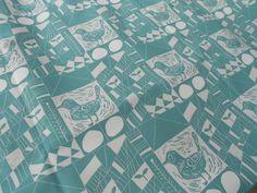 Bird lino print repeat on fabric