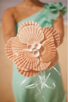 DIY Beach Wedding Inspiration Idea - Learn how to create this pretty petal, starfish and shell bouquet.