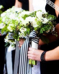 Green and white bouquets with black/white striped ribbon