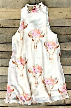 This print is a Summer time staple piece! Our Gimme Your Love Dress is a sleeveless sheer like dress with high neck that ties at the back. Bull head and floral print throughout and cut out back. Made to be flowy and lined for coverage. Southern Style Dresses, Southern Outfits, Country Girls Outfits, Toddler Girl Outfits, Western Outfits, Boho Outfits, Western Wear, Cute Outfits, Head Clothing