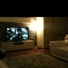 it is time to rest :) having bear, watching tv