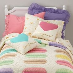Designed exclusively for us by artist Erin Jang, our 100% cotton Confectionary Sheet Set features a subtle, gold colored macaron and heart print.  Add the coordinating Bonjour Pillow for an extra touch of playfulness. Details, details Nod exclusive A Erin Jang  design Sheets are made from 200-thread count cotton percale and feature gold hearts and macarons Extra pillowcase available Imported For complimentary samples, please email customerservice@landofnod.