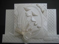 This Card Was Made Using The Following Dies.  Prim Poppy Memory Box  Dancing Tulips Memory Box.  Tessatina Border Memory Box  Debutante Frame Memory Box  Bow Maker
