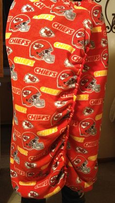 This is made with the NFL KC Chiefs multi color on the top and the bottom is anti- pill fleece (resists pilling) Red. All of my throws are handmade by me with love. This particular one is not tied or flipped ties, instead these are the braid look with stitch finish. this one we did a little different we went from medium braids to small brads to make this into a soft warm snuggie.Red. It fits your body like the fitted sheet fits a bed. I did this because my grandson told me he wanted his to…