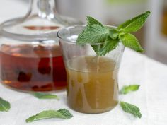 Kentucky Tropics: 1 small sprig fresh mint, 3 ounces bourbon, 2 ounces pineapple juice, ice. Place the mint in a cocktail shaker, then use a muddler or spoon to lightly bruise it. Add the remaining ingredients, then shake until well chilled. Strain into a tumbler.
