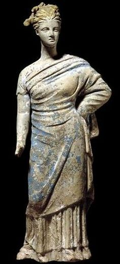 Terracotta Tanagra figure of woman, probably Aphrodite -  from Corinth, 3rd-2nd century BC, at the British Museum