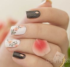 Beautiful flower winter nail art. Combine glitter nail art with carnation flowers and beads on your nails.