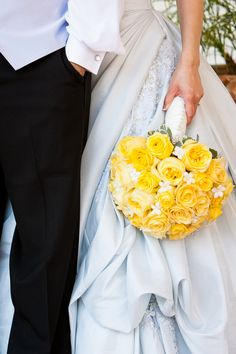 Yellow roses and white stephanotis, full, round, bridal bouquet
