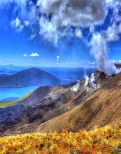 Steaming vents pouring sulphur smell into the air with a view of Lake Taupo, Central North Island, New Zealand
