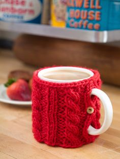 Dress up your coffee and keep your hands warm with this simple knit Mug Cozy. An easy, free pattern from Lion Brand