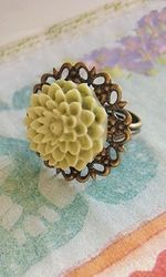 Antique style filigree ring that is adjustable from size 5.5 and up. The ring pad is about 27mm round and the green dahlia flower is about 18mm round. Love this one also, Shabby Apple.
