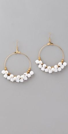 """Kenneth Jay Lane Beaded Hoop Earrings. These 22k gold-plated earrings feature resin beads at the hoops. 2.5"""" (6.5 cm) long including French hook. Made in the USA."""