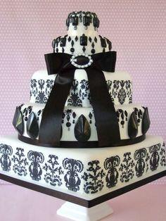 Black and white ribbon wedding cake