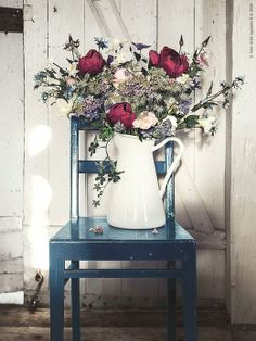 SOCKERÄRT - A white enamelware pitcher makes a beautiful vase for a rustic floral arrangement.