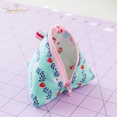 "Here's my sewing tutorial for this cute little pyramid pouch! The finished size measures 3½"". Basic Material Requirements: Scissors, rotary cutter, rulers, sewing thread, pins or clips, sewing machine 7-inch Zipper (one) Fabrics: 4"" x 8"" rectangle Outer Fabric 4"" x 8"" rectangle Lining Fabric 4"" x 8"" rectangle …"