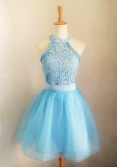 Be the belle of the ball in this tulle lace halter dress. Adorned with a halter neckline and a faux pearl button at the neck, this frock is ...