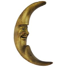 Hand-Carved Crescent Moon Sculpture, circa 1930  | From a unique collection of antique and modern sculptures and carvings at https://www.1stdibs.com/furniture/folk-art/sculptures-carvings/