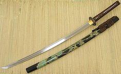 Traditional samurai Katana sword. The Katana remained the key piece of equipment for the samurais throughout their long history. Note the long handle and curved blade. http://jasonoleinik.hubpages.com/hub/SamuraiWarriors