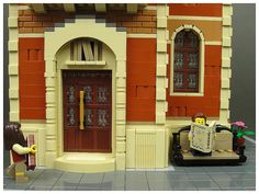 Maxim Baybakov built a quaint Minifig scale library. The facade uses several different colors as well as some very cool window details.