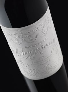McGuigan's 20th Anniversary Edition features a beautiful white embossed label - wine packaging designed by Stranger & Stranger (via @thedieline)