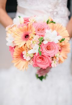 Bridal bouquet of cheerful pink roses and coral gerberas