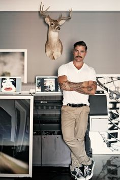 """Bachelor Pad: Inside The Home Of A Celebrity Home Photographer (NSFW) #refinery29 http://www.refinery29.com/douglas-friedman-bachelor-pad#slide-1 """"This is my studio where I spend a good deal of my time. The printer is as big as a piano and definitely gets in the way when I have more than four people over for dinner. And the deer came from a taxidermist in Houston. It was the smallest piece that they had."""" Photograph: Courtesy of Douglas Friedman"""