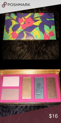 Tart exotic eyes 5-in-1 Amazonian eyeshadow Pallet Beautiful never used eyeshadow. Discounted price because of blue. As you can see I swatched it to test the pigment,  it never used. Thank you for looking!  check out my closet for other great offers 💕 tarte Makeup Eyeshadow