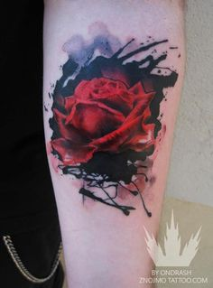 watercolour rose tattoo. Nice use of background watercolour effect which is not easy to achieve when tattooing