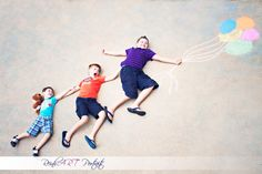 Fun adorable school pictures to do before school starts. Kids floating away! Sidewalk Chalk Photography