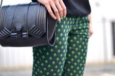 green geometric printed trousers