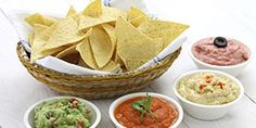tortilla chips with four super bowl dips which are salsa roja guacamole taramasalata and hummus. Best Dip Recipes, Diet Recipes, Cooking Recipes, Favorite Recipes, Healthy Recipes, Party Dips, Easy Dips To Make, Baby Shower Food Easy, Healthy Snacks