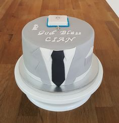 A suit theme 1st Holy Communion Cake with a bible & rosary on top