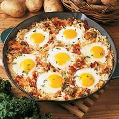 Skillet breakfast: Cook onions and bacon in a skillet, add hashbrowns and cook until brown. Dig out a little hole for each egg, crack them into the hole. Cover and cook until eggs are done.