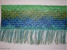 Wall hanging Whaariki (Woven Mat) with shades of Blues & Green hues, a representation of the ocean colours intertwined with the shifting sand ...