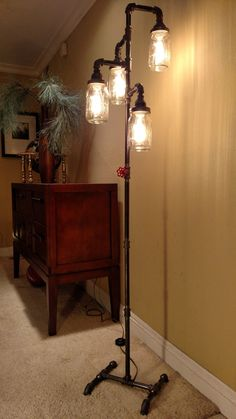 Pipe Floor Lamp 4-fixture Living Room Steampunk Mason Jar by VintagePipeCreations on Etsy https://www.etsy.com/listing/257968831/pipe-floor-lamp-4-fixture-living-room