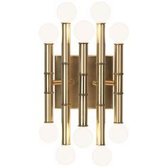 This exquisite metal wall lamp comes in a classic antique brass finish with a design that showcases the mid-century style globe candelabra bulbs. Sconce