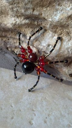 medium beaded spider red black and brown by Natjerm on Etsy, $10.00