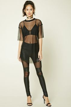 A pair of faux leather leggings featuring mesh inserts down the front, an elasticized waist, and ankle zippers.