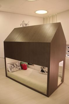 KURA Little Forest House is made from the IKEA KURA loft bed and MDF wrapped in wood veneer. Two levels for sleeping or convert the top into a play space.