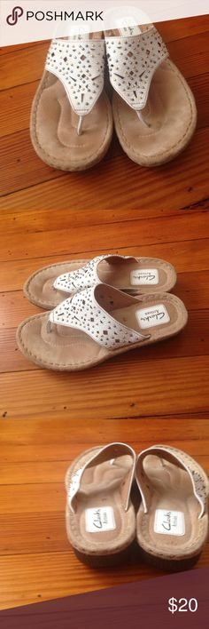 Clarks artisan sandals white size 8 Clarks artisan sandals white size 8. Comfortable, white with cut out design and gold and silver tone studs or beading. Small wedge heels Excellent condition! Make an offer Clarks Shoes Sandals