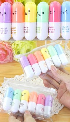 Kawaii emoji face vitamin pill shaped capsule highlighter pen set of 6 that come in a plastic wallet.
