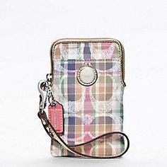 COACH POPPY MADRAS UNIVERSAL CASE, this is such a great piece fits your phone and has slots for your credit cards, id etc.