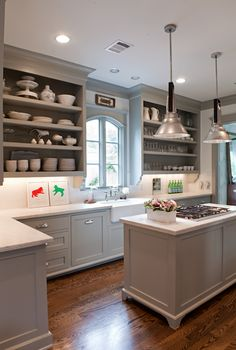 kitchens - Benjamin Moore - Fieldstone - gray kitchen cabinets open shelves farmhouse sink island pendants calcutta marble countertops Chic